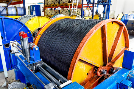 ferrous foundry: Inside the old factory manufacturing electrical cable. Outdated technology mid-20th century.