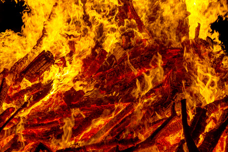 Burning campfire at night, combs flame as texture and background, strong branches burning trees of a forest fire Stock Photo