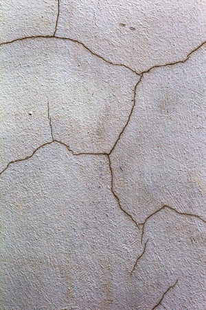 Beautiful old wall with large cracks and texture. Can be used as background Standard-Bild