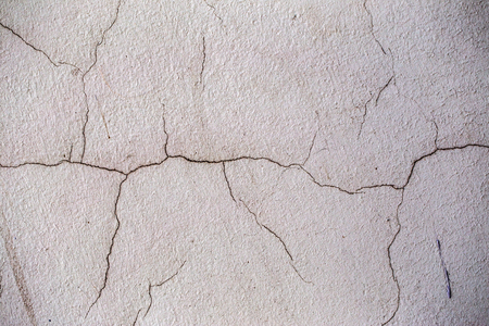 Beautiful old wall with large cracks and texture. Can be used as background Stock Photo