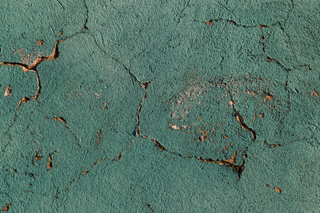 Cracks. Background surface with creative cracks. Web cracks as a background for creative design for a layout. Stone surface of the cement layer with a network of deep cracks. Anxious appearance