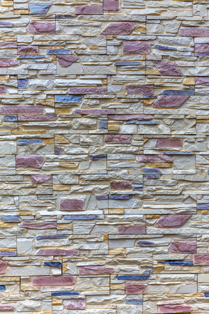 Wall built of natural stone. Can be used as background Standard-Bild