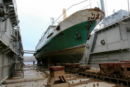 Archive 2008 River port of Ust-Danube was destroyed in of crisis. Old rusty boats on stocks in dry dock of river port. Old river vessels rust on dock repair shop stocks for repair of river vessels