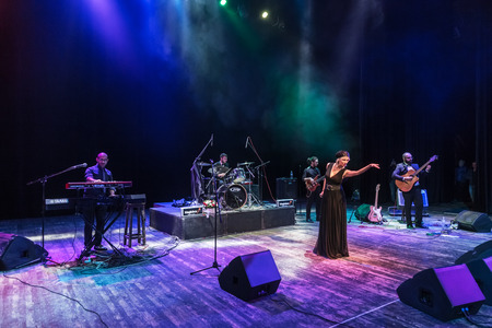 Odessa, Ukraine - November 4, 2018: Musical ensemble, jazz bands of team tribute to show Celentano on stage during creative light and musical show. Cheerful bright show in party club