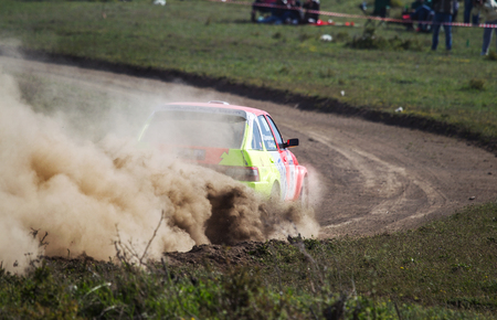 ODESSA, UKRAINE - April 30, 2017: Traditional rally Autocross Championship. Racing car is dangerous enters steep turn of race course, scattering, spraying dirt, dust. Extreme rally driving autocross Editorial