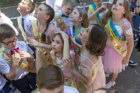 Odessa, Ukraine - May 31,2018: Children's musical group sing and dance on stage during graduation concert of elementary school. Children play. Emotional children's show on stage. Children's creativity Standard-Bild - 127003345