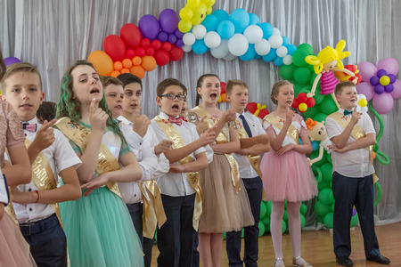 Odessa, Ukraine - May 31,2018: Children's musical group sing and dance on stage during graduation concert of elementary school. Children play. Emotional children's show on stage. Children's creativity Standard-Bild - 127003429