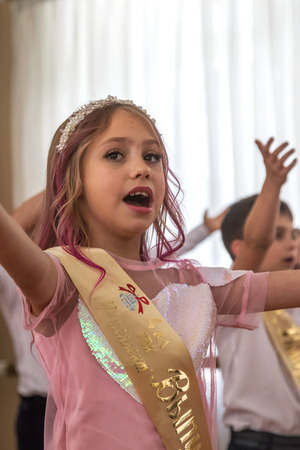 Odessa, Ukraine - May 31,2018: Children's musical group sing and dance on stage during graduation concert of elementary school. Children play. Emotional children's show on stage. Children's creativity Standard-Bild - 127003553