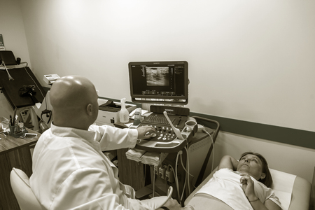 ODESSA, UKRAINE - July 29, 2018: Woman undergoes medical examination of veins on ultrasound sensor in modern technology clinic. Condition of veins and examination of doppler on monitor Redactioneel
