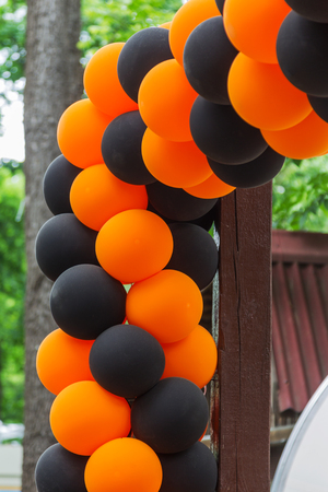 Bright festive multi-colored inflatable balls, black and orange, are woven into the colors of the traditional St. George ribbon - a symbol of Victory, valor with glory in the Great Patriotic War Banco de Imagens