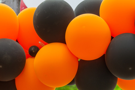 Bright festive multi-colored inflatable balls, black and orange, are woven into the colors of the traditional St. George ribbon - a symbol of Victory, valor with glory in the Great Patriotic War Stock Photo