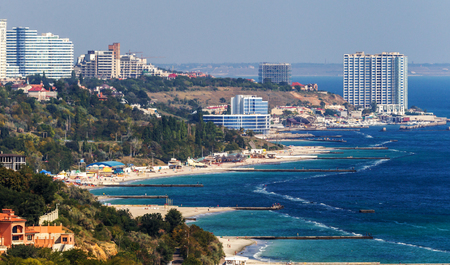 Beautiful view of the sea coast of the Odessa Gulf. Seascape with empty beaches and few tourists, vacationers. Background for tourist advertising poster 写真素材