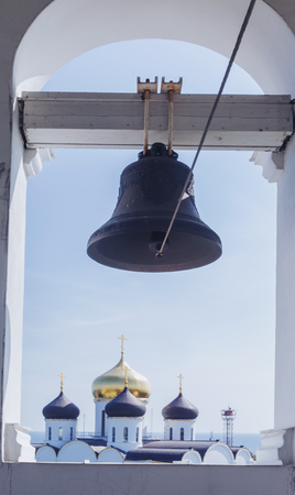 Church bronze bell Ukrainian Orthodox Church of the Moscow Patriarch. The inscription on the bell: Holy Assumption Odessa Patriarchal Monastery, the phrase from the Bible Banco de Imagens