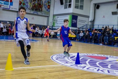 Odessa, Ukraine - December 23, 2018: young children play basketball, participate in childrens sports competitions during celebration childrens sports basketball club of childrens sports school Publikacyjne