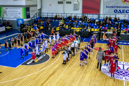 Odessa, Ukraine - December 23, 2018: young children play basketball, participate in children's sports competitions during celebration children's sports basketball club of children's sports school