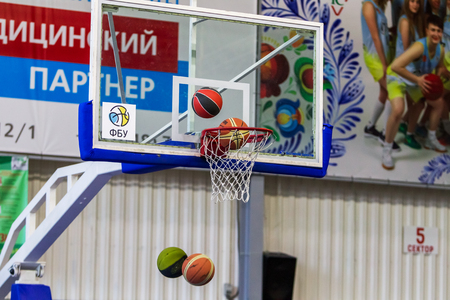 Odessa, Ukraine - December 23, 2018: basketball balls fly into the basketball basket during the celebration of the children's sports basketball club of the children's sports school Редакционное