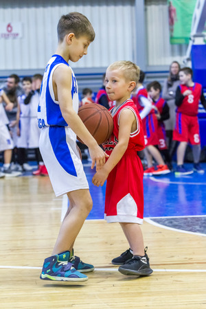 Odessa, Ukraine - December 23, 2018: young children play basketball, participate in children's sports competitions during the celebration of the children's sports basketball club of the children's sports school