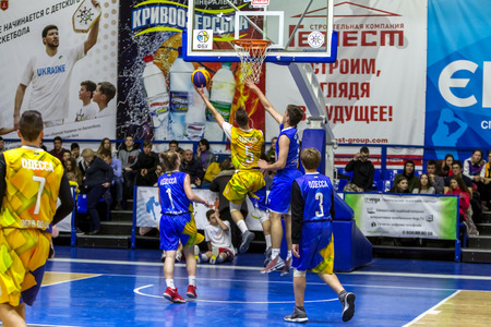 Odessa, Ukraine - Feb. 16, 2019: Sporting holiday children's basketball school league. Teenagers play basketball, participate in children's sports competitions during celebration of children's club Editorial