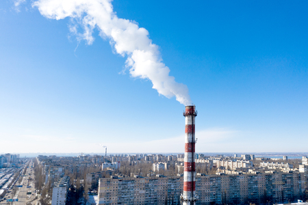 Air pollution, factory pipes, smoke from chimneys on sky background. Concept of industry, ecology, steam plant, heating season, global warming. Factory chimney smoking, smoke emissions from chimneys Standard-Bild - 118760340