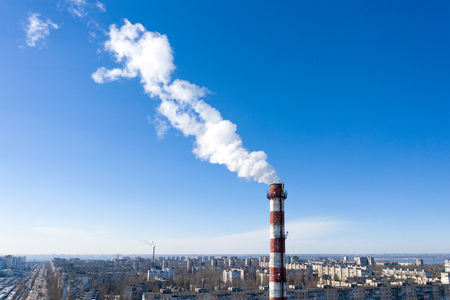 Air pollution, factory pipes, smoke from chimneys on sky background. Concept of industry, ecology, steam plant, heating season, global warming. Factory chimney smoking, smoke emissions from chimneys Standard-Bild - 118760343