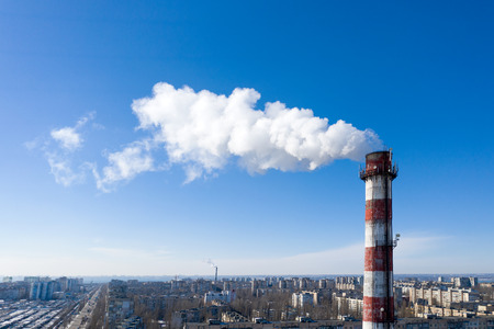 Air pollution, factory pipes, smoke from chimneys on sky background. Concept of industry, ecology, steam plant, heating season, global warming. Factory chimney smoking, smoke emissions from chimneys Standard-Bild - 118760344