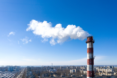 Air pollution, factory pipes, smoke from chimneys on sky background. Concept of industry, ecology, steam plant, heating season, global warming. Factory chimney smoking, smoke emissions from chimneys Standard-Bild - 118760342