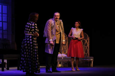 """ODESSA, UKRAINE - FEBRUARY 26, 2016: Actors of theater play role of secret lovers in performance of comedy """"Child for hire�. Actors on  theater stage during comedy. Performance on theater stage"""