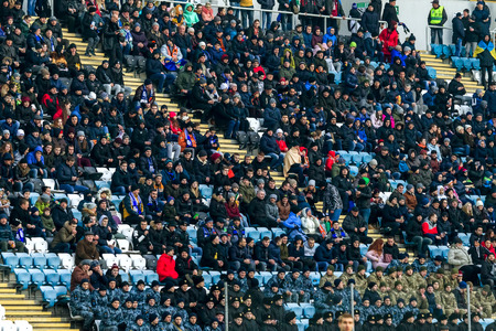 ODESSA, UKRAINE -2 March 2019: Crowds of fans in the stands of the football stadium during the match Shakhtar (Donetsk). Spectators at the stadium. Fayer, lights in the stadiums football stadium