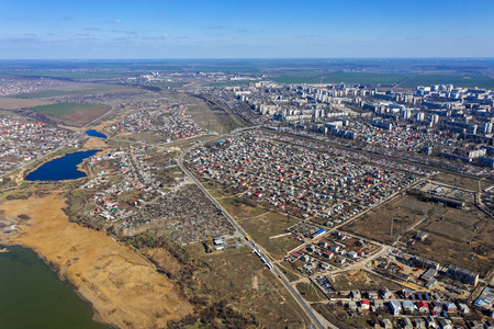 Top view of the coastal zone of the ecological reserve Kuyalnik estuary, Odessa, Ukraine. Aerial view from drone to sea estuaries in a suburban area near urban buildings Фото со стока