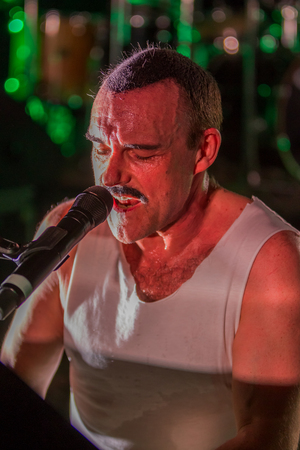 ODESSA, UKRAINE - MARCH 16, 2019: Rock concert Queen tribute show, Bohemian night of the Queen. Rock band copies the performance of the legendary Freddy Merqury group Queen. Rock concert Queen Editorial