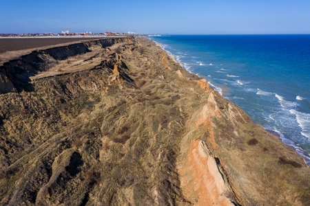 Mountain landslide in an environmentally hazardous area. Large crack in ground, descent of large layers of dirt. Deadly danger at foot of landslide mountain. Soil erosion Avalanche. Steep coast, crack Stock Photo