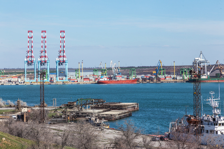 Odessa, Ukraine, South-March 20, 2019: Aerial view of panoramic seaport warehouse and container ship, crane vessel is working to deliver containers. South Sea Industrial Port, Port Factory Editoriali