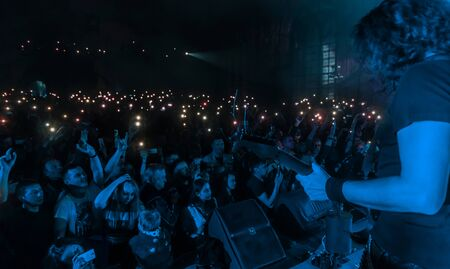 ODESSA, UKRAINE - March 23, 2019: viewers in auditorium of concert hall emotionally meet their favorite performers. Audience in theater hall. Viewers like performance on stage Redakční