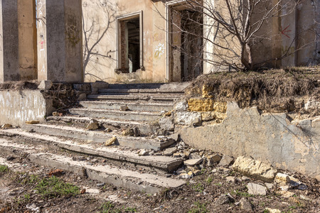 Mystical interior, ruins of an abandoned ruined building of house of culture, theater of USSR. Old destroyed walls, corridor with garbage and dirt. Destroyed molding, plaster ornaments, bas-relief Imagens