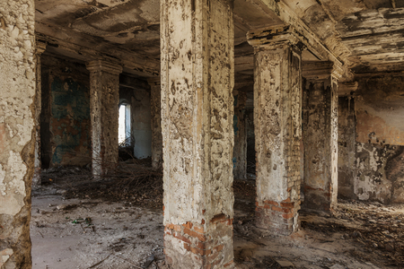 Mystical interior, ruins of an abandoned ruined building of house of culture, theater of USSR. Old destroyed walls, corridor with garbage and dirt. Destroyed molding, plaster ornaments, bas-relief