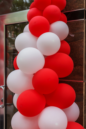 Making the entrance with colorful balloons during the celebration of a solemn event. Party or birthday banner with colorful balloons Фото со стока