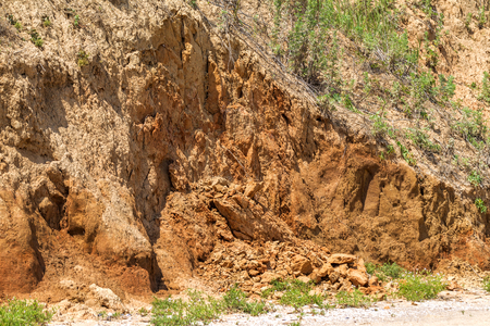 Landslide zone on Black Sea coast. Rock of sea rock shell. Zone of natural disasters during rainy season. Large masses of earth slip along slope of hill, destroy houses. Landslide - threat to life 版權商用圖片