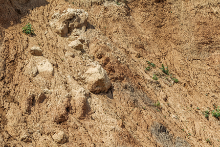 Landslide zone on Black Sea coast. Rock of sea rock shell. Zone of natural disasters during rainy season. Large masses of earth slip along slope of hill, destroy houses. Landslide - threat to life