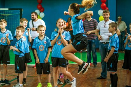 ODESSA, UKRAINE - MAY18, 2019: Young children play rugby during final championship games in hall. Children's sport. Children play rugby 5. Emotional reaction to victory and defeat. Final winners teams