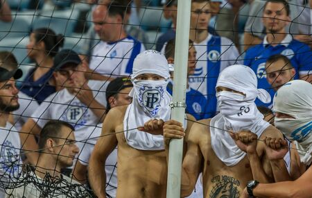 ODESSA UKRAINE - July 28, 2019: spectators at the stadium. Crowds of fans in the stands of a football stadium during the match Shakhtar (Donetsk)-Dynamo (Kiev). Grandstand with fans. Stands with football fans