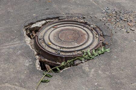 Large cracks, chips. Broken asphalt shifted landslide after flood. Destroyed road by water. Groundwater flushing. Concept of destruction of roads from nature. Consequences of flood. Broken  street Foto de archivo