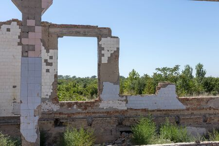 Ruined house. Remains of old houses. Apocalypse. Abandoned city. City of ghosts. Ruins of old historic houses destroyed by an earthquake and devastating operation of urban structures. Broken building Фото со стока