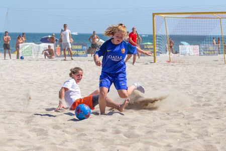 Odessa, Ukraine-July 21, 2019: Beach Soccer Championship among amateur women on beach. Soccer in sand. Young beautiful girls playing beach football on sand of city beach. Football on sand