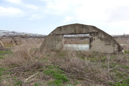 Greenhouse for growing vegetables. Abandoned nobody needed greenhouse of industrial capital. Destroyed agriculture, economic crisis Ukraine 2019. Large industrial greenhouse. Industrial agriculture 写真素材