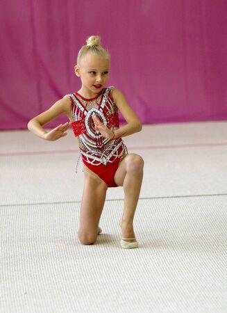 ODESSA, UKRAINE - September 21, 2019: children, girls compete in rhythmic gymnastics at Ukrainian championship in rhythmic gymnastics among children. Young gymnasts competing in arena of the gym