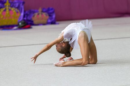 ODESSA, UKRAINE - September 21, 2019: children, girls compete in rhythmic gymnastics at Ukrainian championship in rhythmic gymnastics among children. Young gymnasts competing in arena of the gym