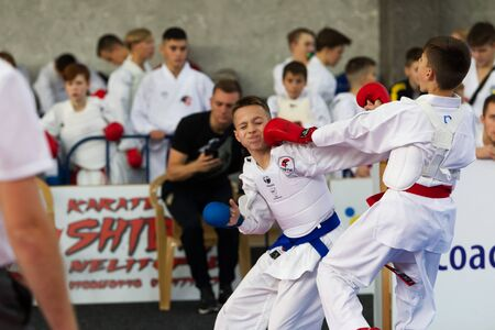Odessa, Ukraine - September 30, 2019: Karate Championship among children of athletes. Best karate fighters from demonstrate their ability to fight obscenities. Battle of young karate cadets