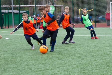 ODESSA, UKRAINE October 26, 2019: FC SHAKHTAR SOCIAL program for development of children's football sports, healthy lifestyles. Younger kick soccer on green futsal field during soccer festival Editorial