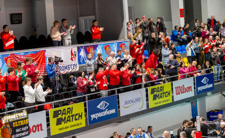 KAMENSKY, Ukraine - February 14, 2020. Sports spectators, fans do not support their team during women's volleyball tournament. Sports fans, ultras on grandstand 版權商用圖片 - 142875893