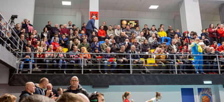 KAMENSKY, Ukraine - February 14, 2020. Sports spectators, fans do not support their team during women's volleyball tournament. Sports fans, ultras on grandstand 新聞圖片
